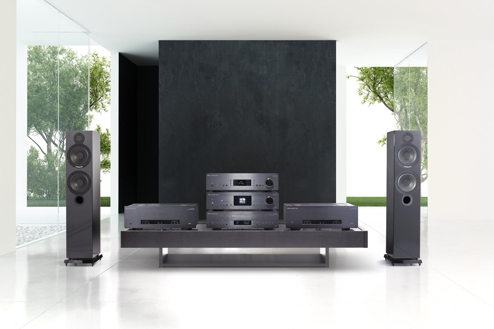 Full Azur 851 Series black setup in white room with tower speakers