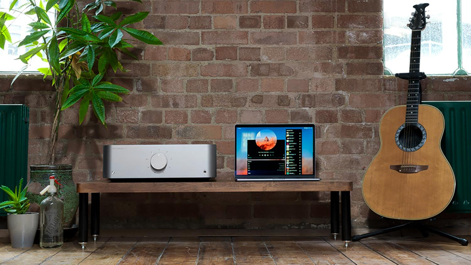Edge A Integrated Amplifier, laptop and guitar