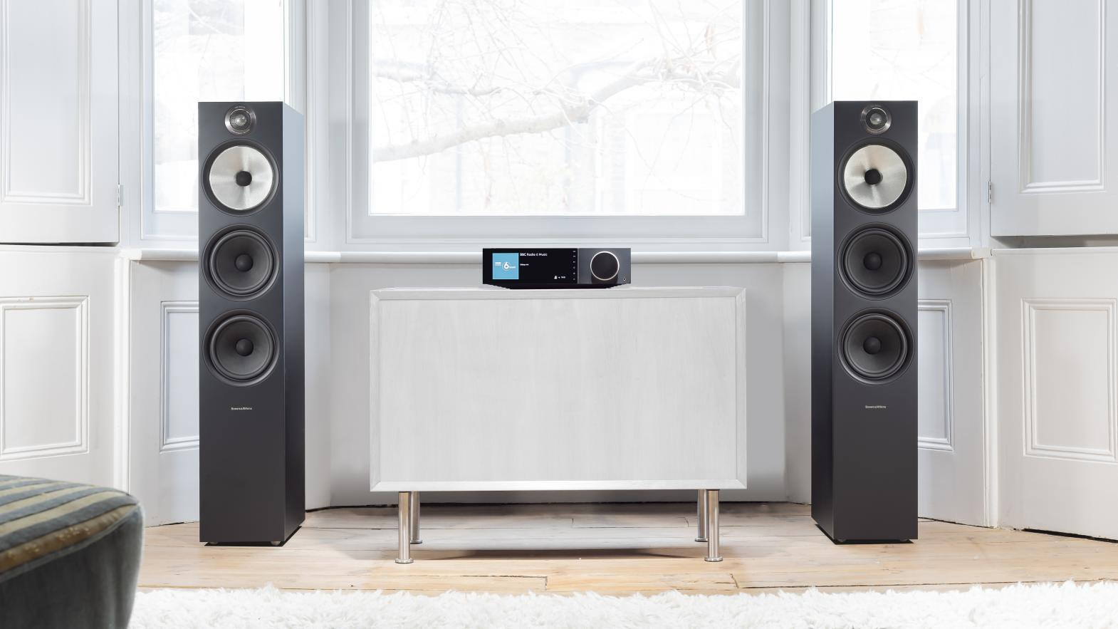 Evo and tower speakers in white room
