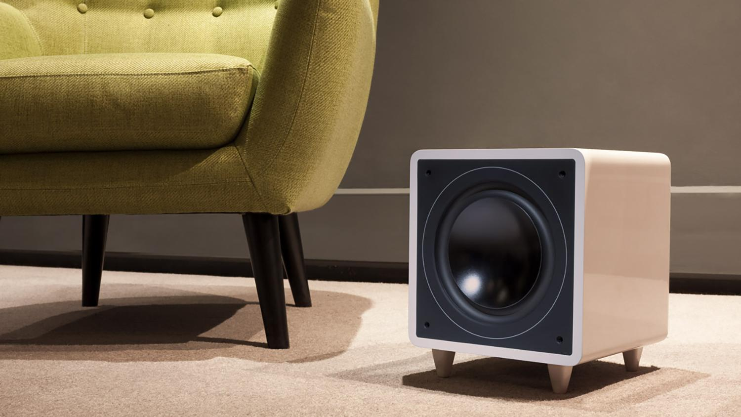 Minx X301 300W subwoofer and yellow arm chair